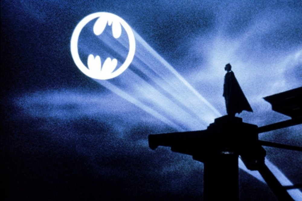 Batman looking at Bat Signal