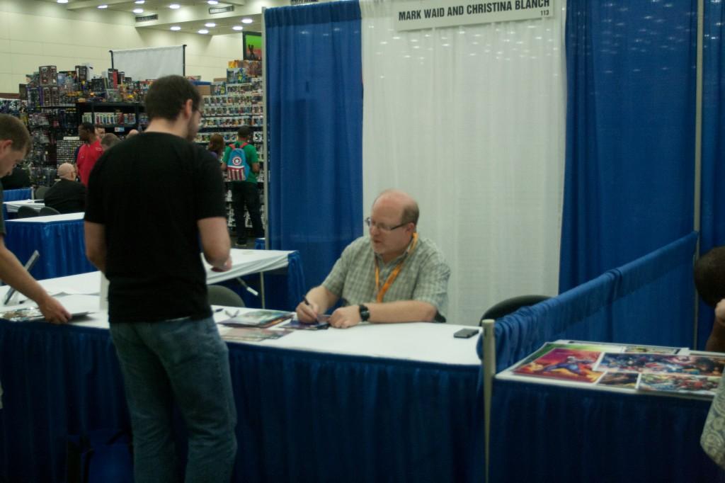 Mark Waid signs comics for fan