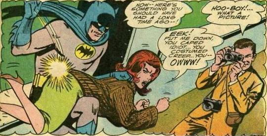 Batman Spanks someone